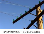 old wooden power poles with... | Shutterstock . vector #1011973381