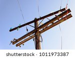 old wooden power poles with... | Shutterstock . vector #1011973387