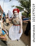 Small photo of Atlanta, GA, USA - October 21, 2017: A man dressed like the Queen of Hearts from Alice in Wonderland waits for the start of the Little Five Points Halloween parade on October 21, 2017 in Atlanta, GA.