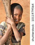 african boy in the yard of a... | Shutterstock . vector #1011979564