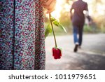 Stock photo sadness love in ending of relationship concept broken heart woman standing with a red rose on hand 1011979651