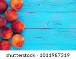 side border of ripe juicy red... | Shutterstock . vector #1011987319