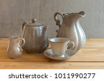 tea set is gray on a wooden... | Shutterstock . vector #1011990277