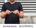 man breake down a cigarette | Shutterstock . vector #1011990931
