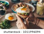 eggs on toast with avocado... | Shutterstock . vector #1011996094
