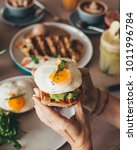 eggs on toast with avocado... | Shutterstock . vector #1011996784