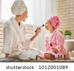 happy loving family. mother and ... | Shutterstock . vector #1012001089