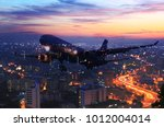 airplane flying around the... | Shutterstock . vector #1012004014