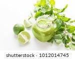 green healty drink in mason jar ... | Shutterstock . vector #1012014745