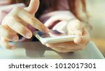 woman use of smartphone at... | Shutterstock . vector #1012017301