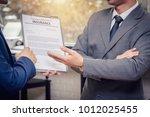 insurance sale agent suggest an ... | Shutterstock . vector #1012025455