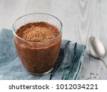chocolate chia pudding in glass ... | Shutterstock . vector #1012034221