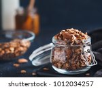 homemade granola in glass jar... | Shutterstock . vector #1012034257