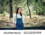 beautiful young woman in denim... | Shutterstock . vector #1012039399