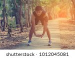 handsome man doing exercises... | Shutterstock . vector #1012045081