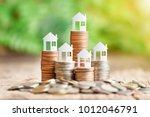 house model on coins stack for... | Shutterstock . vector #1012046791
