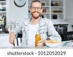 indoor shot of bearded ginger... | Shutterstock . vector #1012052029