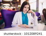 strict business woman sitting... | Shutterstock . vector #1012089241