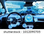 cockpit of autonomous car and... | Shutterstock . vector #1012090705