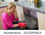 failed cooking in kitchen | Shutterstock . vector #1012095814