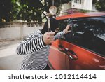 Thieves used a hammer to smash the windscreen to looting valuables. - stock photo