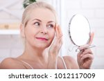 forty years old woman looking...   Shutterstock . vector #1012117009