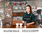 barista woman at workplace in...   Shutterstock . vector #1012123099