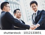 three businessmen shaking hands ...   Shutterstock . vector #1012133851