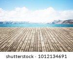 wooden floor on beach with...   Shutterstock . vector #1012134691