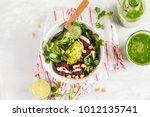 green vegetable vegan salad...   Shutterstock . vector #1012135741