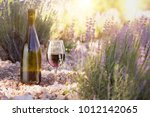 red wine bottle and wine glass... | Shutterstock . vector #1012142065