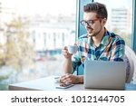 man is doing his freelance job... | Shutterstock . vector #1012144705