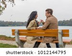 Small photo of amorous couple on a park bench