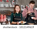 couple of barista are working...   Shutterstock . vector #1012149619