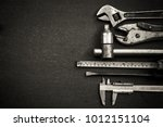 working tools on wooden table... | Shutterstock . vector #1012151104
