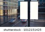 two blank signs on the post at... | Shutterstock . vector #1012151425
