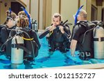 diving instructor and students. ... | Shutterstock . vector #1012152727