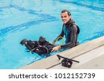 portrait of a happy diving... | Shutterstock . vector #1012152739