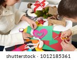 young couple making origami... | Shutterstock . vector #1012185361
