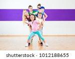 children in zumba class dancing ... | Shutterstock . vector #1012188655