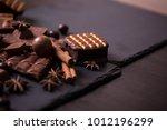 broken chokolate bars and... | Shutterstock . vector #1012196299