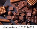 broken chokolate bars and... | Shutterstock . vector #1012196311