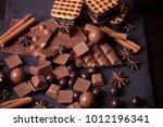 broken chokolate bars and... | Shutterstock . vector #1012196341