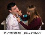 woman attacks her unfaithful... | Shutterstock . vector #1012198207