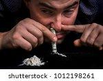 junkie man snorting cocaine...   Shutterstock . vector #1012198261