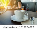 coffee cup in coffee shop with... | Shutterstock . vector #1012204327