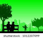 the grandson runs by carrying... | Shutterstock .eps vector #1012207099