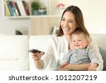 happy mother and baby watching... | Shutterstock . vector #1012207219