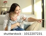 mother and son looking outdoors ... | Shutterstock . vector #1012207231