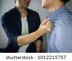 man grab other by the collar ... | Shutterstock . vector #1012215757